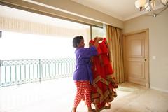 Indian bride getting her wedding attire ready.