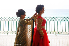 Marvelous Indian bride gettin last touchups for wedding.
