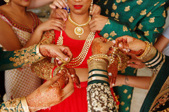 Indian bride getting her jewelry on.