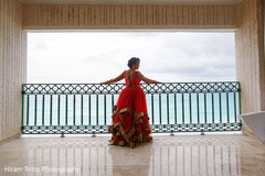 Gorgeous Indian bride at the balcony ready for ceremony.