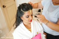 Indian bride getting her tikka on.