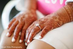 Indian bride's mehndi art closeup capture.