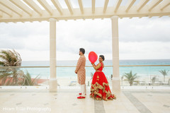 Indian bride and groom first look scene.