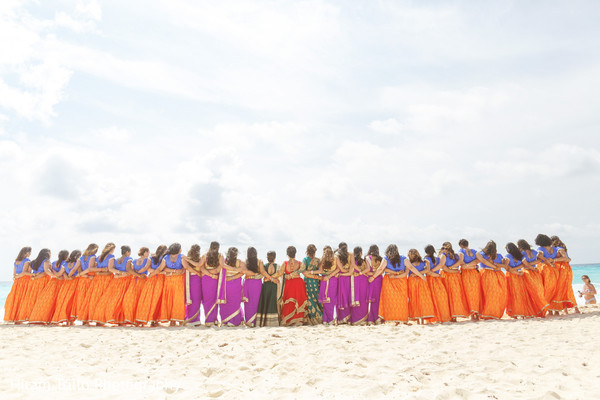 Stunning capture of Indian bride with bridesmaids at the beach.