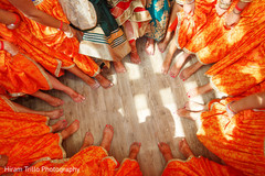 Marvelous capture of Indian bridesmaids and bride's mehndi art on feet.