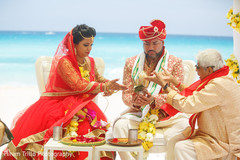 This bride and groom during traditional wedding ritual.
