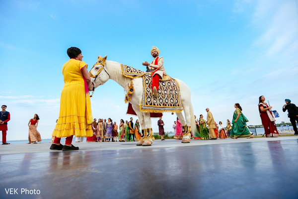 Elegant indian groom riding baraat white horse