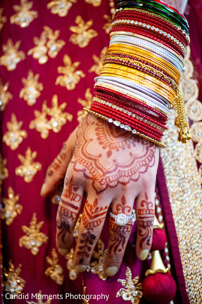 Lovely Indian bride wearing her bangles and her engagement ring.