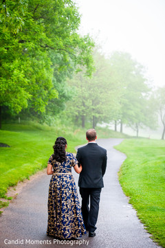 Adorable Indian couple walking together.