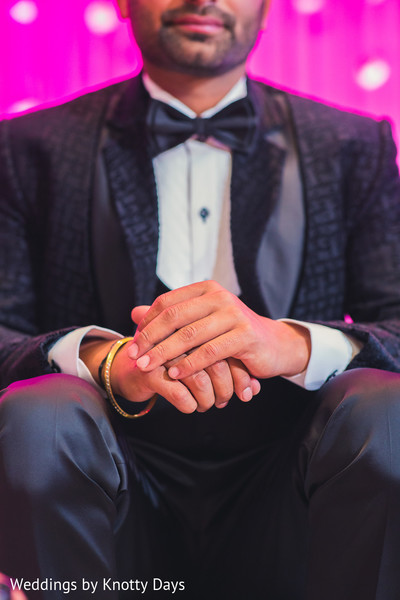 Indian groom's hands closeup capture.