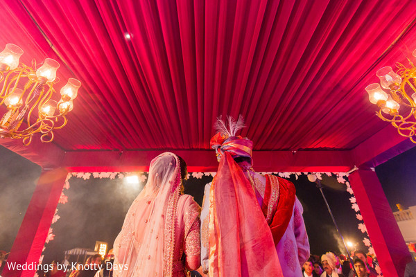 Happy Indian couple during their wedding ceremony capture.