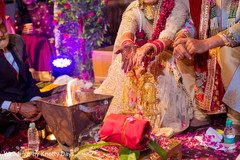 Indian bride throwing rose petals close up.