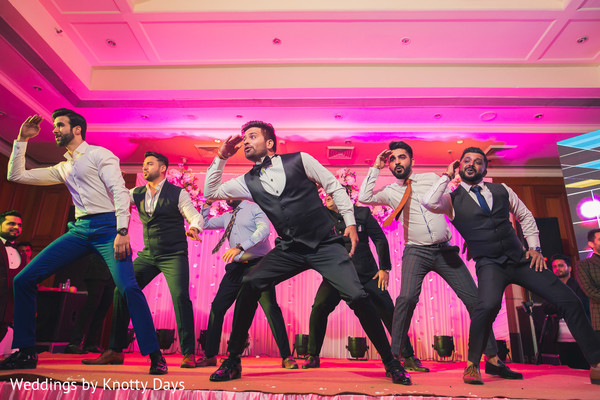 Stunning performance of Indian groom and groomsmen at wedding reception.