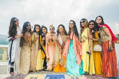 Elegant Indian bride and bridesmaids  outdoors capture.