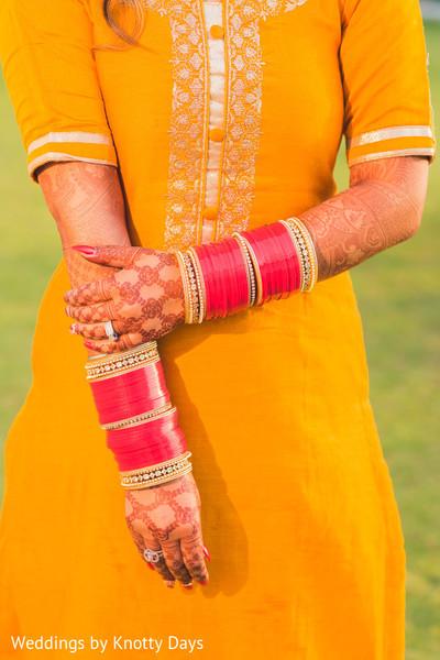 Marvelous Indian bride's bangles and mehndi art.