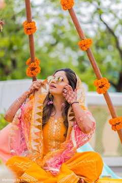 Marvelous look of Indian bride on her mehndi party outfit.