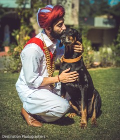 Tender shot of indian groom with dog