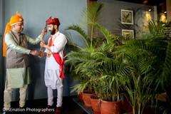 Charming indian groom getting ready scene