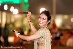 Adorable indian bride during dandia raas ritual