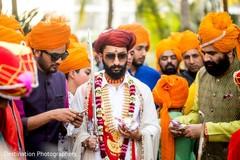 Traditional indian groom's milni ritual