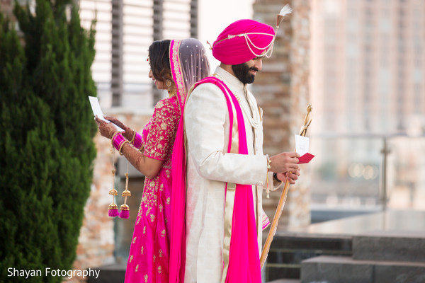 Marvelous Indian bride and groom reading their sweet notes.