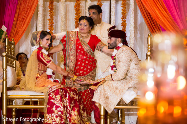 Marvelous capture of bride given to groom ceremony ritual.