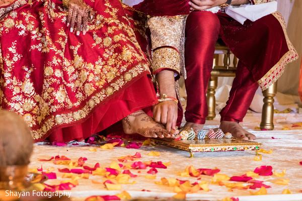 Indian bride and grooms closeup capture of saptapadi ritual.