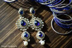 Stunning Indian bride's earrings capture.