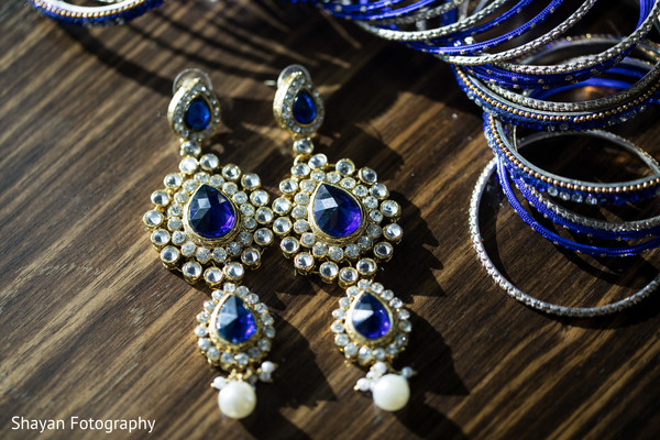 Stunning Indian bride's earrings capture.