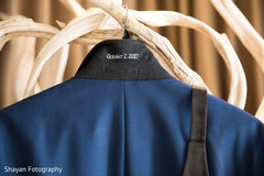 Closeup capture of personalized wedding date on groom's suit.