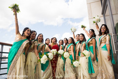 Lovely capture of Indian bride and bridesmaids outdoors.