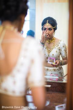 Marvelous capture of bride putting her bindi.