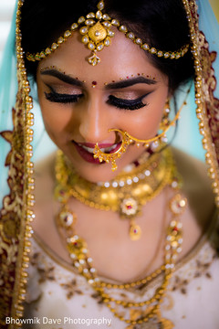 Majestic Indian bride with her wedding jewelry on.
