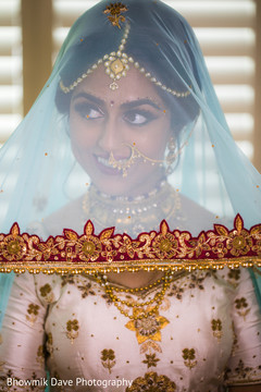 Beautiful bride with her Ghoonghat on face.