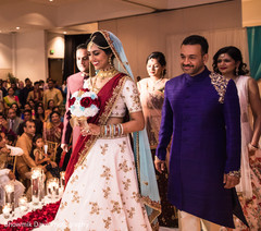 Indian bride walking the wedding ceremony aisle capture.