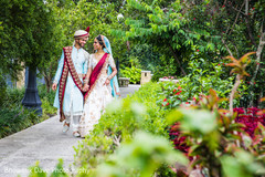 Adorable Indian couple walking holding hands.