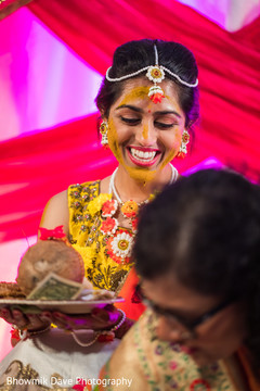 Lovely maharani holding the coconut at haldi ceremony.