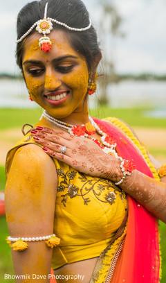 Maharani posing with turmeric paste on.
