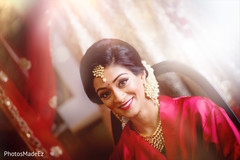 Beautiful indian bride being dolled up for her ceremony