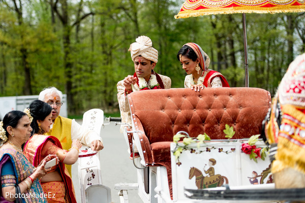 Lovely capture of indian bride and groom on their wedding carriage