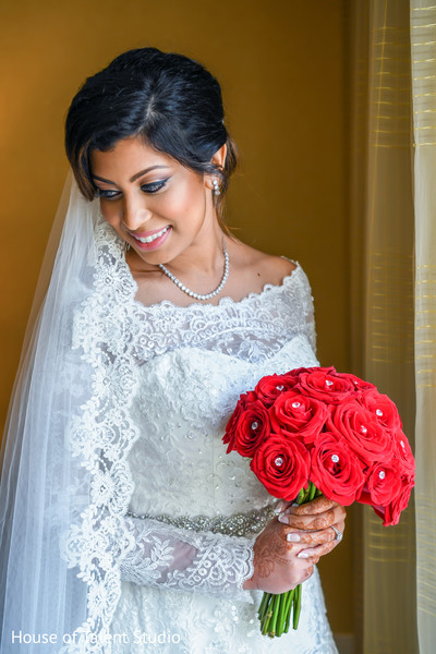 Stunning Indian bride on her white wedding dress.