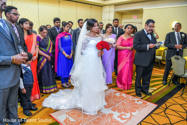 Indian brides entrance to wedding ceremony moment.