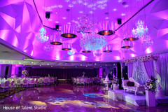 Splendid Indian wedding reception tables, mandap and dance floor decor.