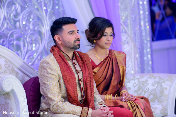 Lovely indian couple enjoying their wedding reception.