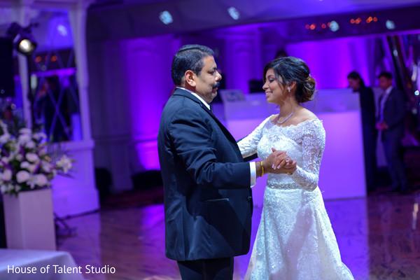 Indian bride dancing with parent capture.