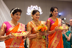 Sweet indian bride and bridesmaids at their wedding ceremony.