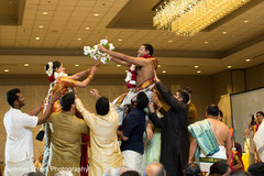 Indian couple being lifted up capture