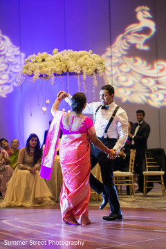 Indian groom dancing with mother