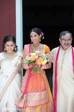 Lovely Maharani walking in to her ceremony with parents capture.