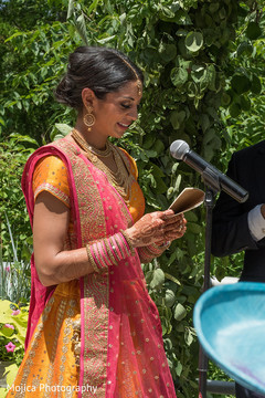 Indian bride reading her bows capture.